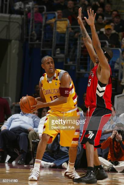 Lucious Harris of the Cleveland Cavaliers looks to pass the ball against Jalen Rose Jalen Rose of the Toronto Raptors during the game on February 8...