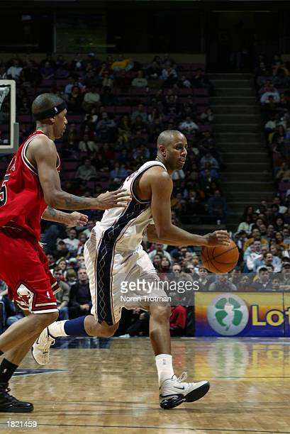 Lucious Harris of the New Jersey Nets drives past Jalen Rose of the Chicago Bulls during the NBA game at Continental Airlines Arena on February 14...