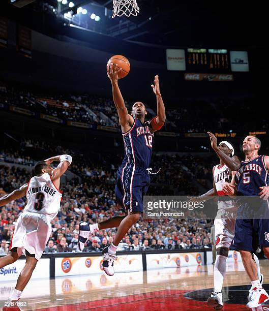 Lucious Harris of the New Jersey Nets goes for a layup during the NBA game against the Portland Trail Blazers at The Rose Garden on November 28 2003...
