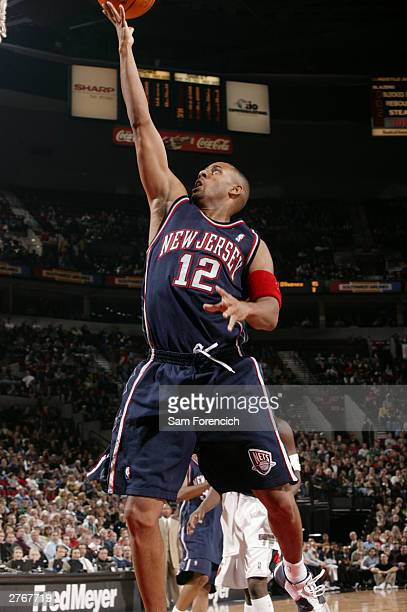 Lucious Harris of the New Jersey Nets lays the ball in during a game against the Portland Trail Blazers on November 28 2003 at the Rose Garden Arena...