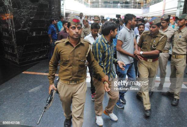 Lucknow Police run an antiRomeo operation at Saharaganj mall on March 22 2017 in Lucknow India The antiRomeo squads are formed by the police on order...