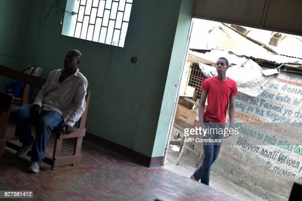 Luckson Samedi arrives to attend an Evangelic church service close to to his house in Nazon in the haitian capital of Haiti PortauPrince on May 23...