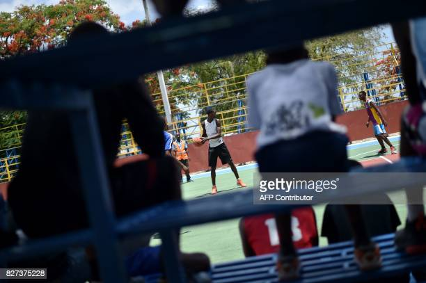 Luckson Samedi practices at basketball game in the Haitian capital of Haiti PortauPrince on July 1 2017 Luckson and other young Haitian basketball...