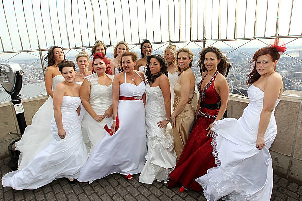 14 Lucky Brides To Be Pose On The 86th Floor Observation Deck Of Empire State