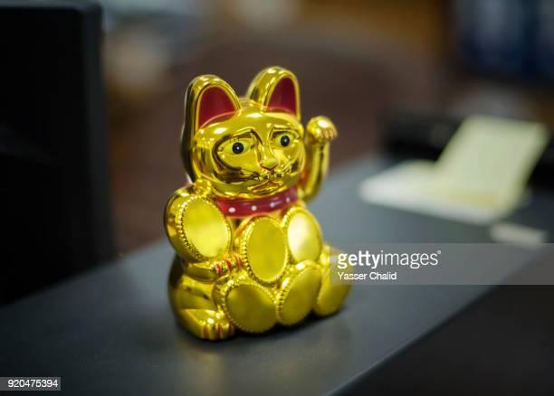 lucky cat chinese - maneki neko stock photos and pictures