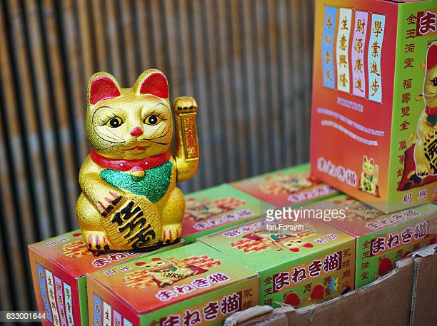 Lucky cats are sold during the Chinese New Year celebrations to mark The Year of the Rooster on January 29 2017 in Newcastle Upon Tyne United Kingdom...