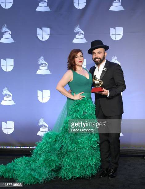 Lucky Diaz and Alisha Gaddis of The Lucky Band, winners of Best Latin Children's Album, pose in the press room during the 20th annual Latin GRAMMY...