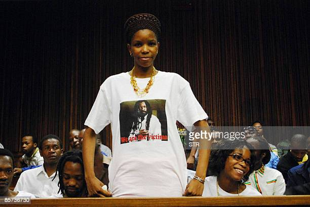 Lucky Dube's wife Zanele wearing a short portraiting slain music star Lucky Dube stands before the handing down of judgement of Sifiso Mhlanga Julio...