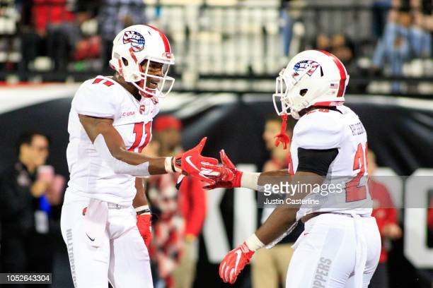 Lucky Jackson celebrates with Demetrius Cain of the Western Kentucky Hilltoppers after a touchdown in the game against the Old Dominion Monarchs on...