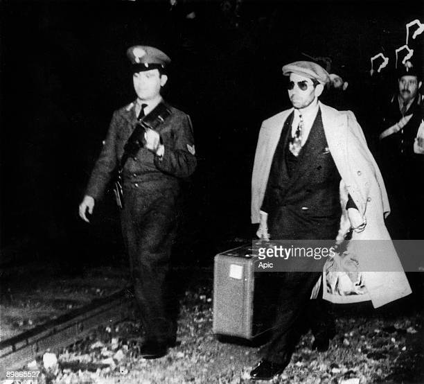 Lucky Luciano after expulsion from USA he left Cuba here in Genova at the station he's going to Sicily 1947