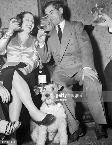 Lucky Luciano Drinking with Woman at House Party