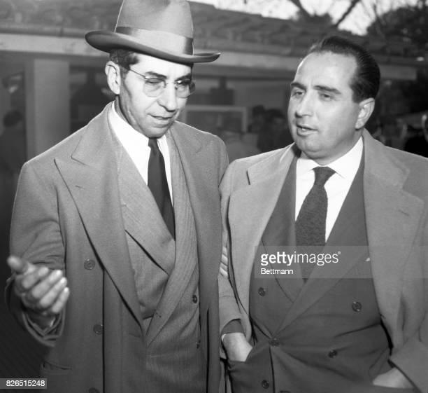 Lucky Luciano who was tossed out of the United States is shown as he was interviewed by Michael Chinigo Rome bureau manager of International News...