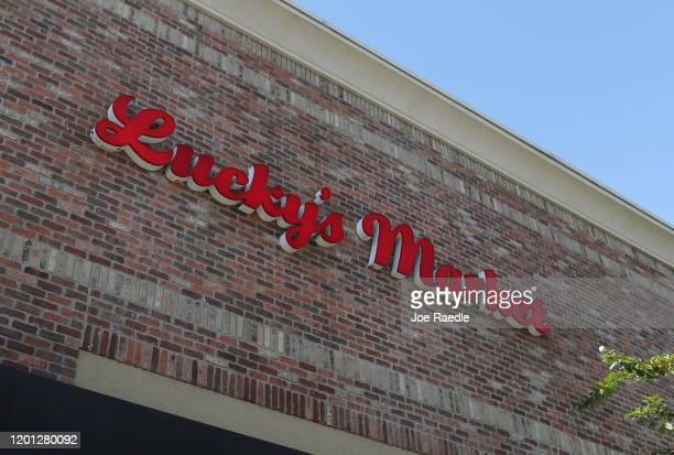 Lucky Market grocery store sign is seen as the chain made public that it plans to shutter 32 of its 39 stores in nine states on January 22 2020 in...