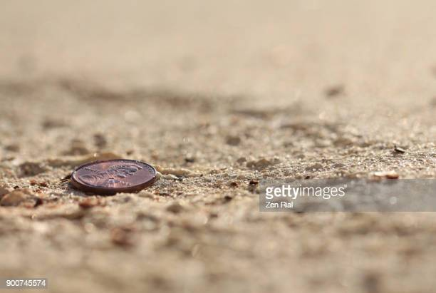 lucky penny on the sidewalk - us penny stock pictures, royalty-free photos & images