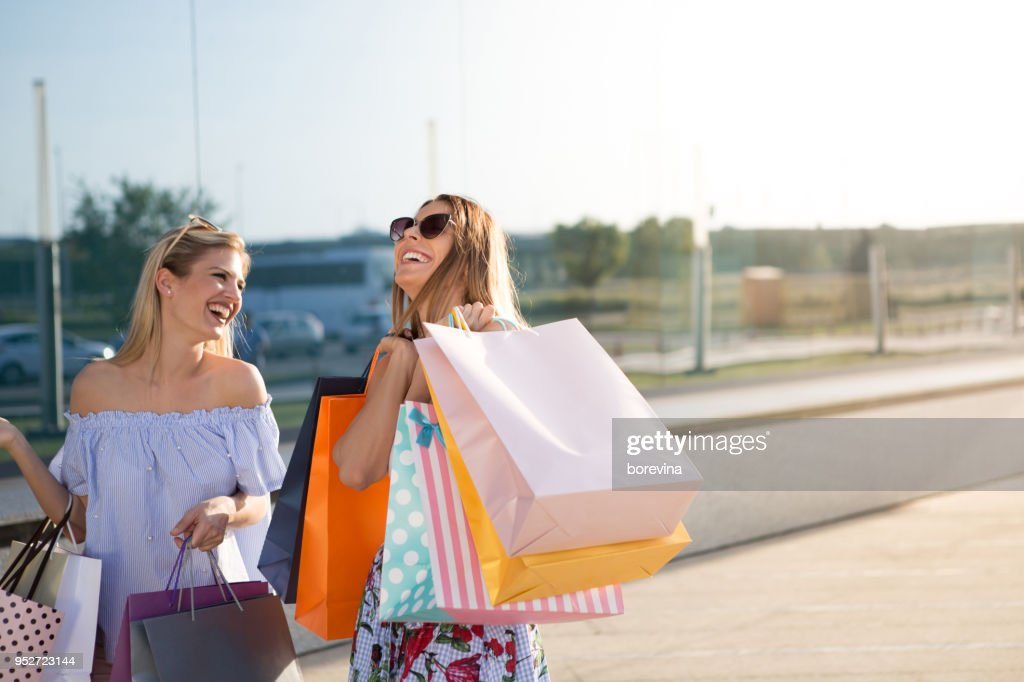 Lucky shopping in a shopping center with your best friend. : Stock Photo