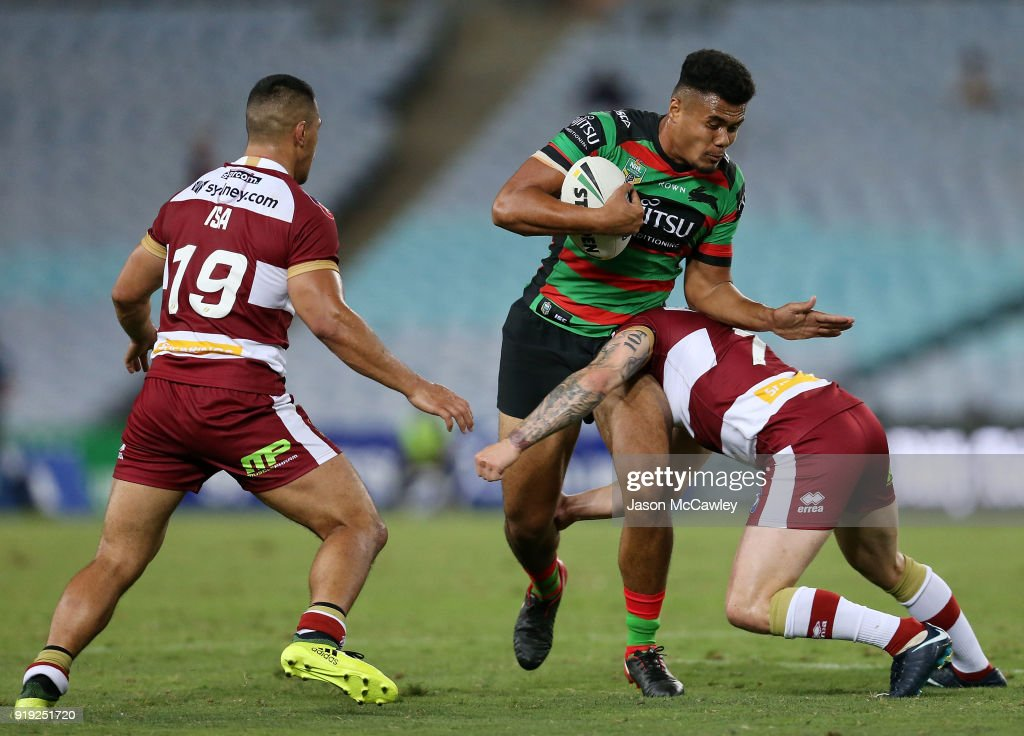 Lucky Taavale of the Rabbitohs is tackled during the NRL trial match between the South Sydney Rabbitohs and Wigan at ANZ Stadium on February 17, 2018 in Sydney, Australia.