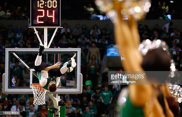 'Lucky' the Boston Celtics mascot performs a dunk in between play against the Houston Rockets during the game on January 11 2013 at TD Garden in...