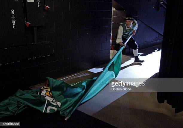 Lucky the Celtics mascot prepares to head out onto the court with the Celtics banner before the start of tonight's game The Boston Celtics host the...