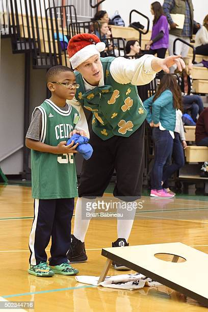 Lucky the Leprechaun of the Boston Celtics plays games and give gifts to childres from Hom for Little Wanderers on December 19 2015 at the Boston...