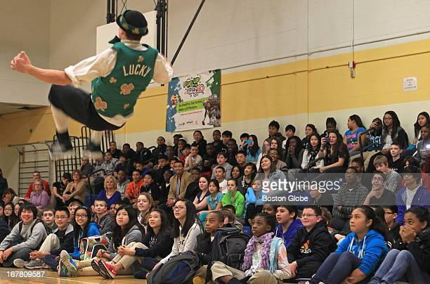 Lucky the mascot of the Celtics does a backflip for the students The Boston Celtics host a 'Stay In School' assembly with students at the Murphy K8...