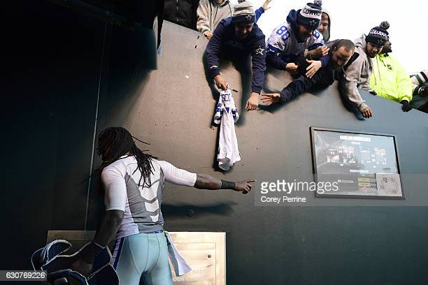 Lucky Whitehead of the Dallas Cowboys gives away some gear to fans after the game against the Philadelphia Eagles at Lincoln Financial Field on...