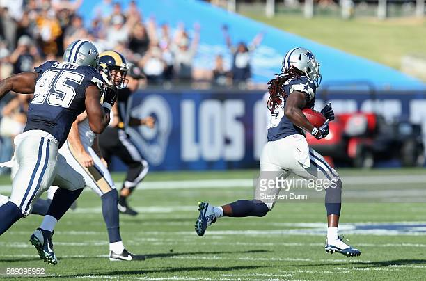 Lucky Whitehead of the Dallas Cowboys returns the opening kickoff 101 yards for a touchdown against the Los Angeles Rams at the Los Angeles Coliseum...