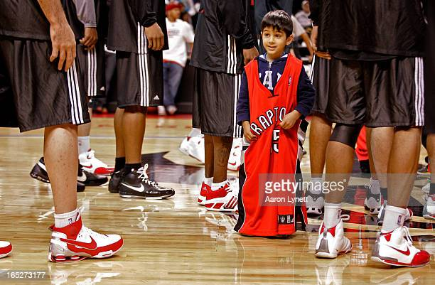 FANS Lucky young Raptors fan Leandros Kouris of Missisauga received an authentic gamework jersy from Jorge Garbajosa as the Toronto Raptors held an...