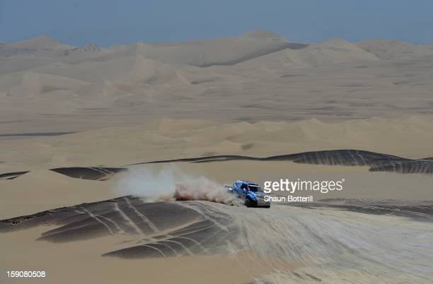 Luco Alvarez and copilot Ronnie Graue of team Toyota compete during the stage from Pisco to Nazca on day three of the 2013 Dakar Rally on January 7...