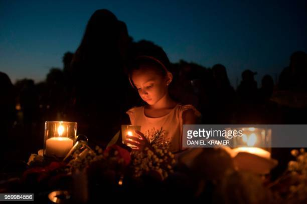 Lucretia Martinez stands before various momentos people have left during a candelight vigil in Santa Fe Texas for the victims of the mass shooting on...