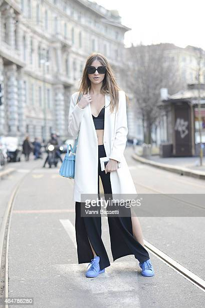 Lucrezia Trinca poses wearing Zara jacket and pants Nasty Girl top Adidas shoes and Saint Laurent bag on February 28 2015 in Milan Italy