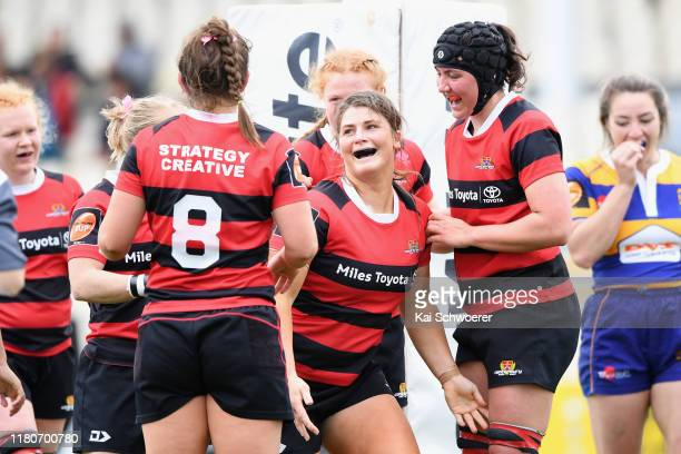 Lucy Anderson of Canterbury is congratulated by team mates after scoring a try during the Farah Palmer Cup Quarter Final match between Canterbury and...