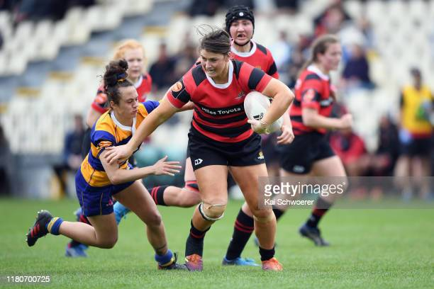 Lucy Anderson of Canterbury runs through to score a try during the Farah Palmer Cup Quarter Final match between Canterbury and Bay of Plenty at...