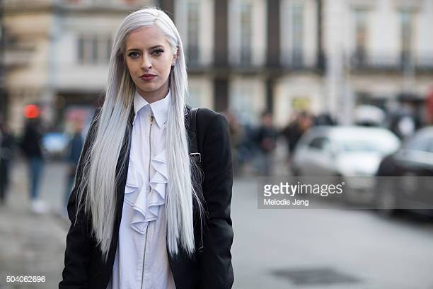 Lucy Anderson wears a ruffleshirt wit ha zip collar and shows off her long platinum blonde hair during The London Collections Men AW16 at Victoria...