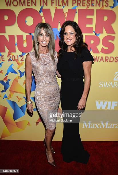 Lucy Award Honoree Bonnie Hammer and President of Women in Film Cathy Schulman arrive at the 2012 Women In Film Crystal Lucy Awards held at The...