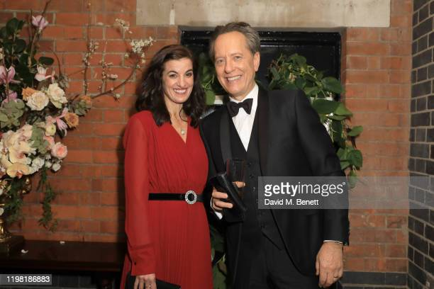 Lucy Bevan and Richard E Grant pose the Netflix BAFTA after party at Chiltern Firehouse on February 2 2020 in London England