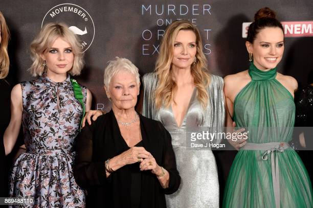 Lucy Boynton Dame Judi Dench Michelle Pfeiffer and Daisy Ridley attend the 'Murder On The Orient Express' World Premiere at Royal Albert Hall on...