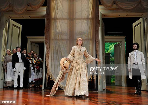 Lucy BriggsOwen as Olga and Alexander Vlahos as Yeletsky with artists of the company in Ivan Turgenev's Fortune's Fool directed by Lucy Bailey at the...