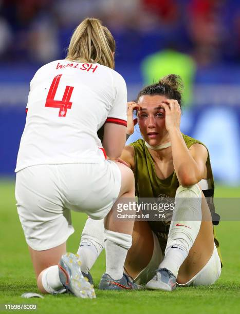 Lucy Bronze and Keira Walsh of England look dejected following the 2019 FIFA Women's World Cup France Semi Final match between England and USA at...