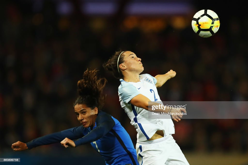 Lucy Bronze of England battles for the ball with Amel Majri of France during the International friendly match between France and England held at Stade du Hainaut on October 20, 2017 in Valenciennes, France.