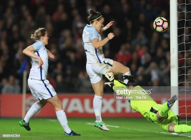 Lucy Bronze of England beats goalkeeper Manuela Zinsberger of Austria to score their second goal during the Women's International Friendly match...