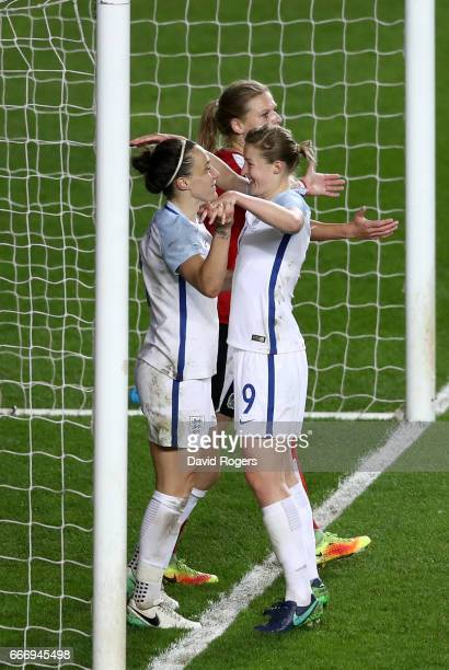 Lucy Bronze of England celebrates as she scores their second goal with Ellen White during the Women's International Friendly match between England...