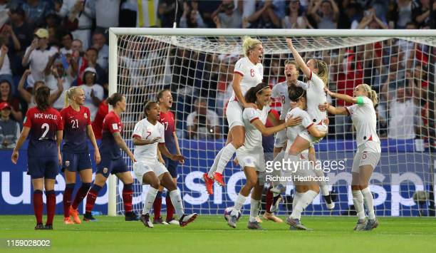 Lucy Bronze of England celebrates scoring the third goal during the 2019 FIFA Women's World Cup France Quarter Final match between Norway and England...