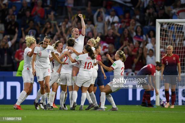Lucy Bronze of England celebrates with teammates after scoring her team's third goal during the 2019 FIFA Women's World Cup France Quarter Final...