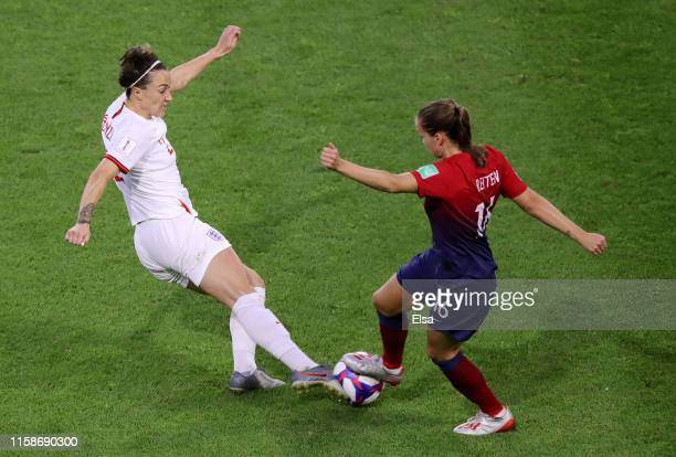 Lucy Bronze of England is challenged by Guro Reiten of Norway during the 2019 FIFA Women's World Cup France Quarter Final match between Norway and...