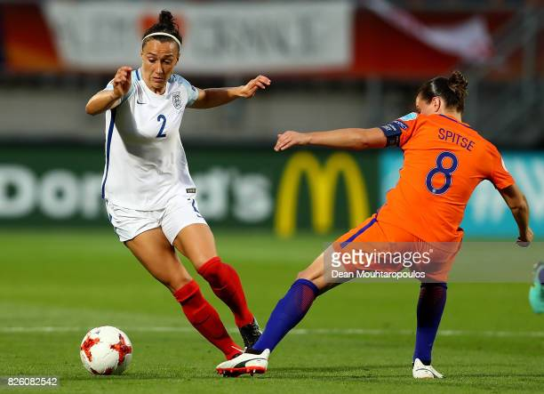 Lucy Bronze of England skips past the challenge of Sherida Spitse of The Netherlands during the UEFA Women's Euro 2017 Semi Final match between...