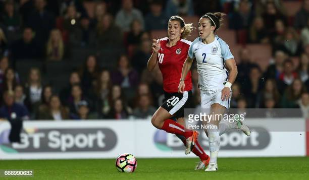 Lucy Bronze of England Women moves forward with the ball watched by Lisa Makas of Austria Women during the International Friendly match between...