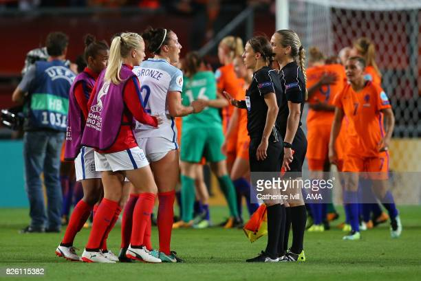 Lucy Bronze of England Women talks to referee Stephanie Rappart after the UEFA Women's Euro 2017 semi final match between Netherlands and England at...