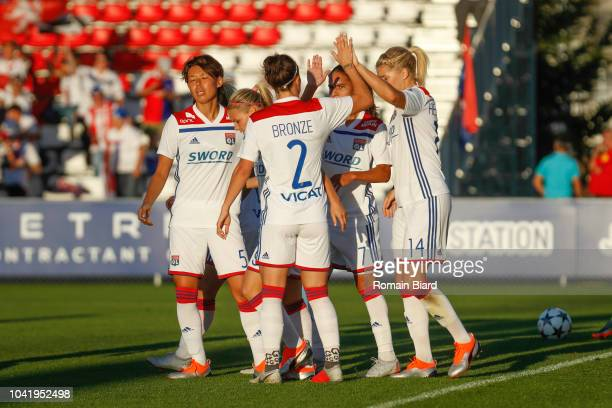 Lucy Bronze of Lyon and Ada Hegerberg of Lyon and Saki Kumagai of Lyon and Amel Majri of Lyon celebrate during the Women's Champions League match...