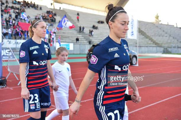 Lucy Bronze of Lyon and Camille Abily of Lyon come out for the Division 1 match between Paris FC and Lyon on January 14 2018 in Evry Bondoufle France