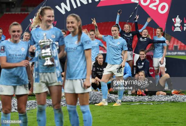 Lucy Bronze of Manchester City makes a joke as Georgia Stanway, Sam Mewis and Janine Beckie of Manchester City celebrate with the Vitality Women's FA...